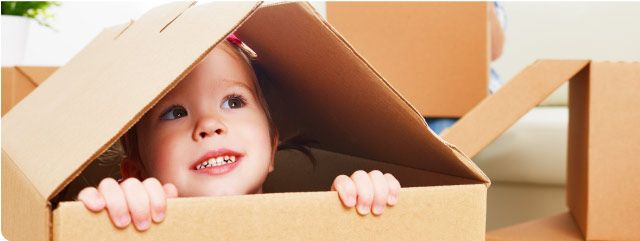 child in packing box